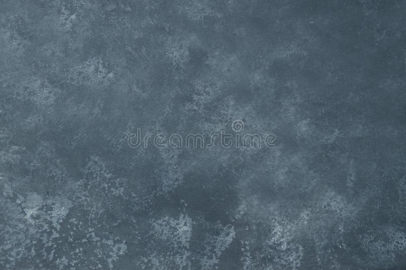 Grey grunge textured wall. Dark stone background. Copy space stock photography