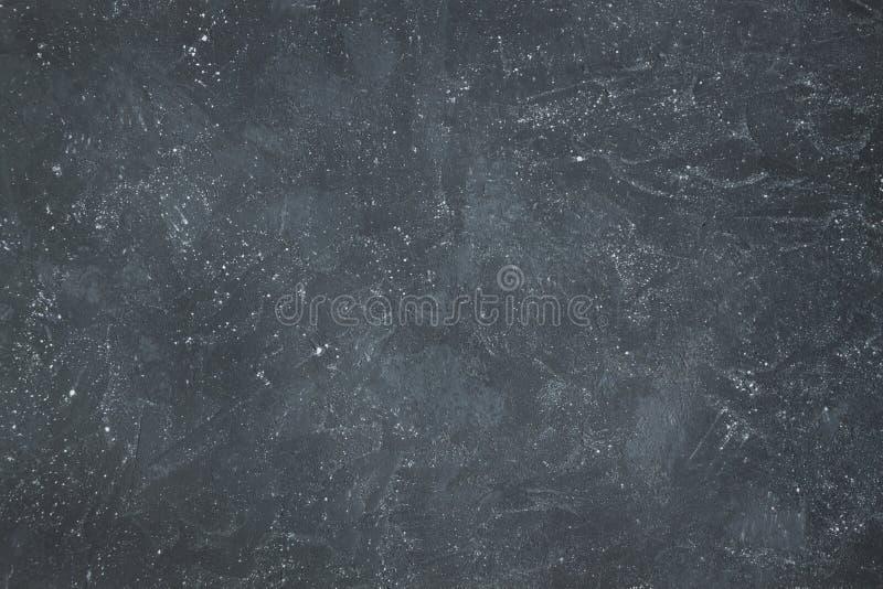 Grey grunge textured wall. Dark stone background. Copy space stock image