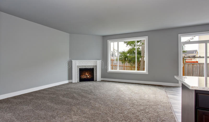 Grey house interior of living room with firwplace and carpet floor. stock photography