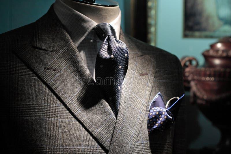 Grey jacket, dark blue tie and handkerchief stock images