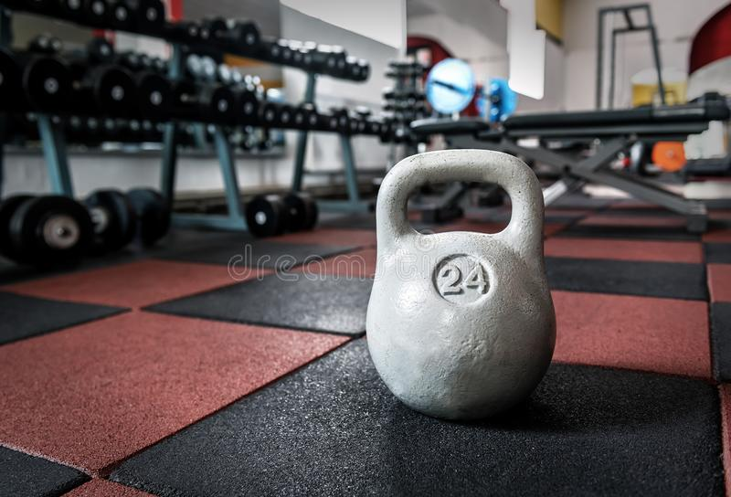 Grey Kettle Bell. In the gym royalty free stock photography