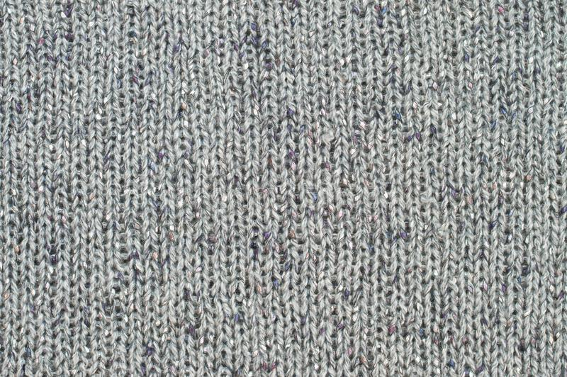 Grey knit texture. Rough woolen grey knit texture as background stock images