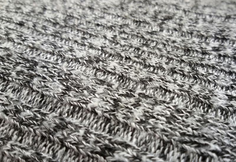 Grey knitted fabric texture as background. Beautiful pattern. Closeup of a grey knitted fabric texture as background. Beautiful graying pattern royalty free stock photos