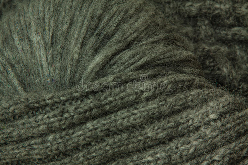 Grey knitted yarn rolled into ball background. Grey knitted yarn rolled into ball royalty free stock photo