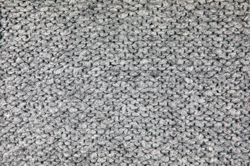 Grey Knitwear Fabric Texture. Loose Knitwear Fabric Texture with wool fibers. Repeating Machine Knitting Texture of warm Sweater. Grey Knitted Background blanket stock photos