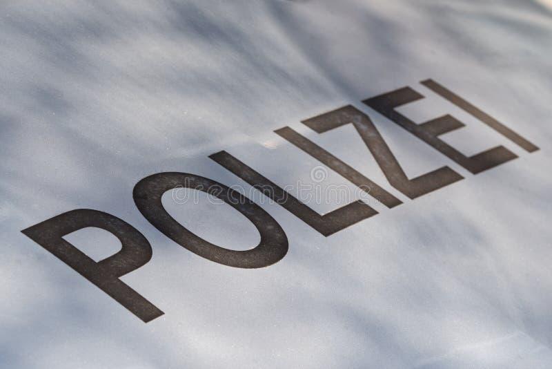 Grey lettering `Polizei` on silver bonnet stock illustration