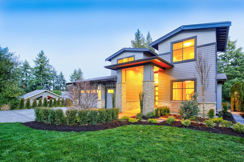 Grey luxury modern two story tall house exterior with stone columns stock photography