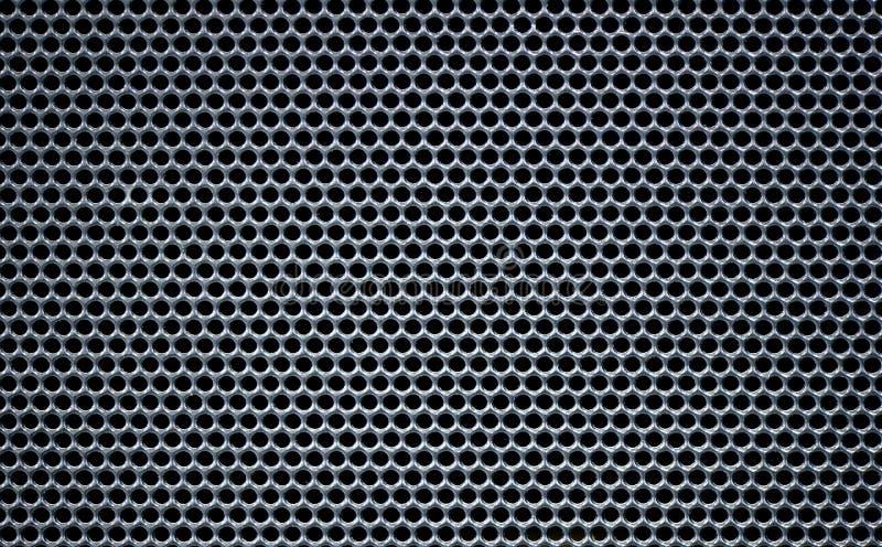 Grey Macro Metallic grid round holes hive texture. Macro Metallic grey grid round holes hive texture net with black background royalty free stock image