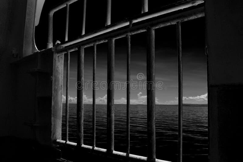 Grey Metal Frame Window Near Body Of Water royalty free stock photography