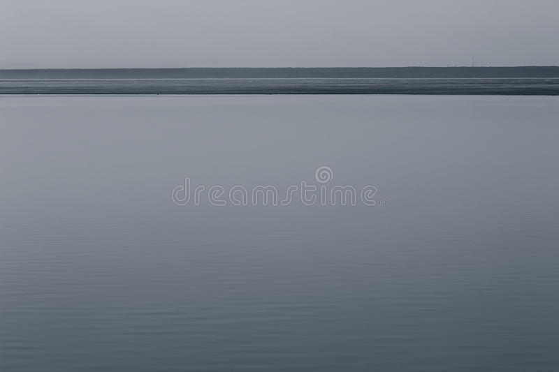 Grey minimalist landscape with a horizon line. Copy space. Background royalty free stock photo