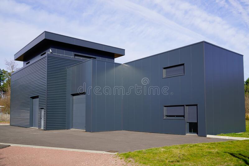 Grey modern business unit industrial building outside gray architecture. A grey modern business unit industrial building outside gray architecture stock images