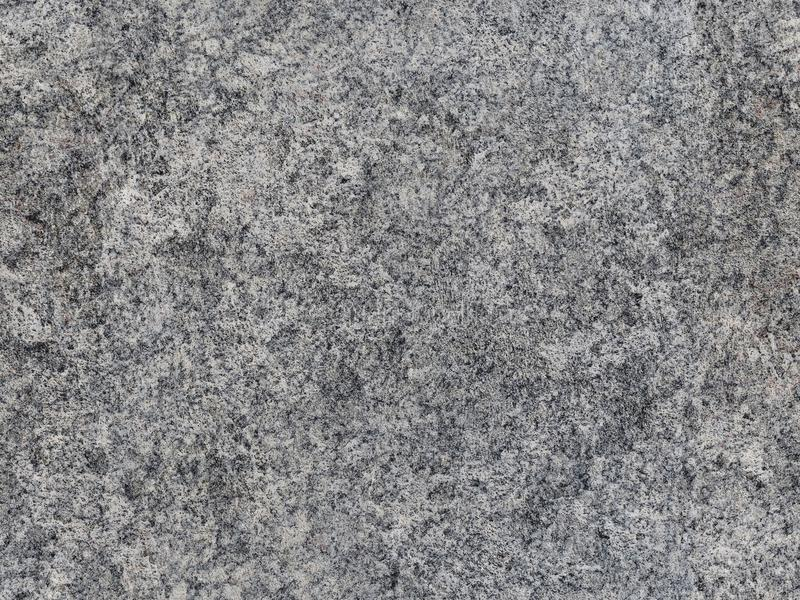 Grey natural raw seamless granite stone texture pattern background. Rough natural stone seamless texture surface with cracks, dent. S, sharp edges. Light gray royalty free stock image