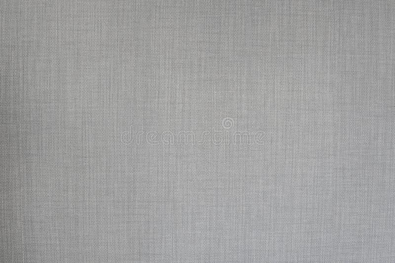 Grey neutral textile texture, often used for furniture covers, pillows, chairs or sofas. Grey neutral textile texture, often used for furniture covers, pillows royalty free stock photo