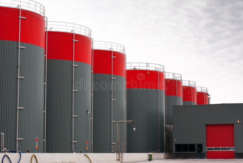 Grey oil storage tanks. New red and gray oil storage tanks royalty free stock photography