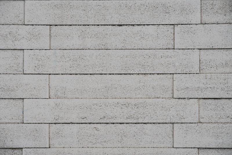 Grey painted panel fence brickwork style stock image