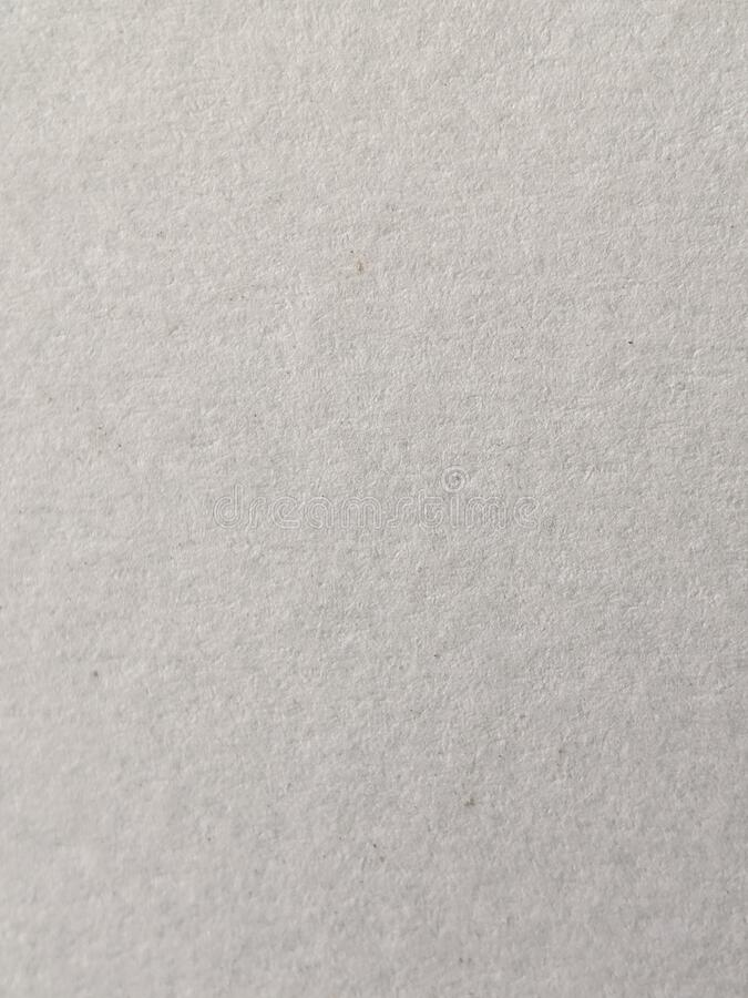 Grey paper surface texture close up, top view.  royalty free stock image