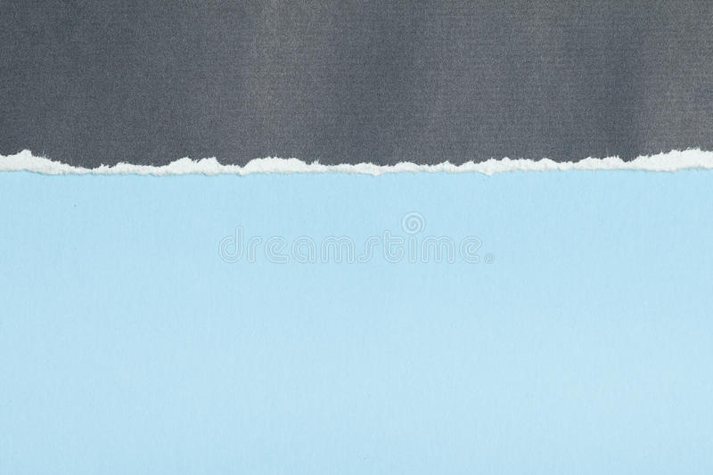 Grey Paper With Torn Edge On Blue Royalty Free Stock Photo