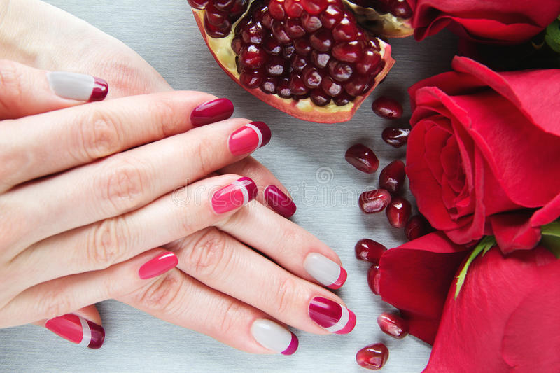 Grey, pink and red asymmetry nail art manicure royalty free stock photo
