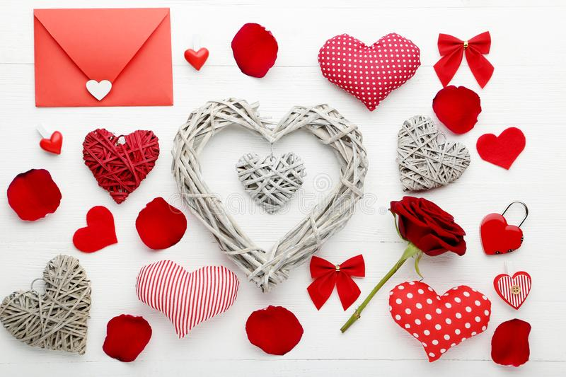 Grey and red hearts with rose and envelope royalty free stock photos