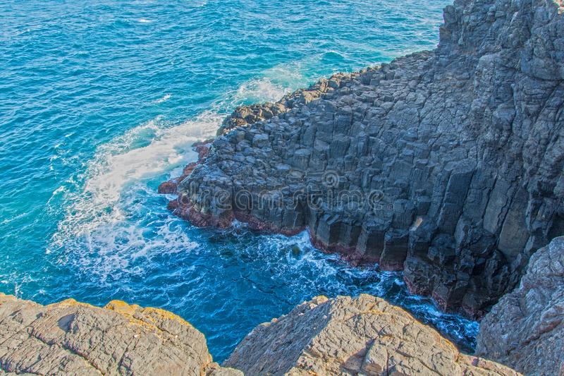Grey Rock Formation Near Water royalty free stock photo