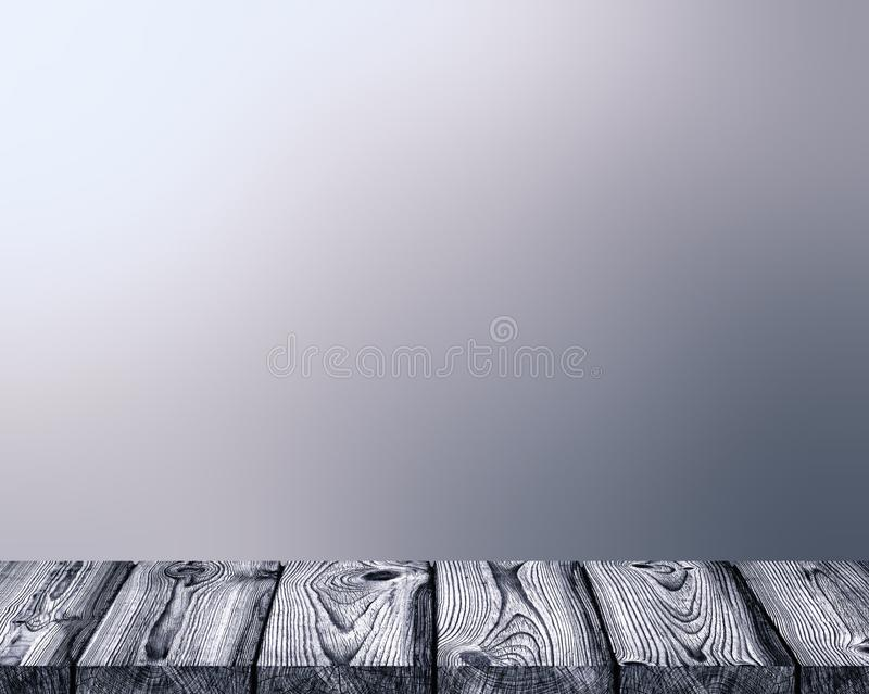 Grey rustic wooden empty table. Brutal gray sky blurred background. stock image