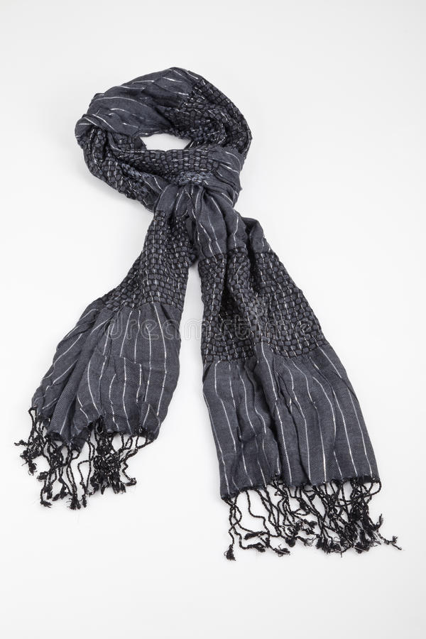 Grey scarf woven with fringes on white background. Gray woven fringed scarf tied on white background stock image