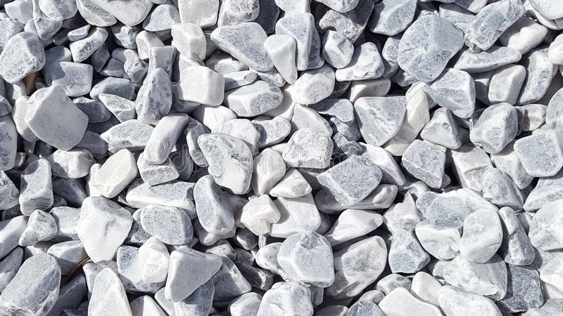 Grey Seamless tile background of small stones on sidewalk. Or wall royalty free stock photo