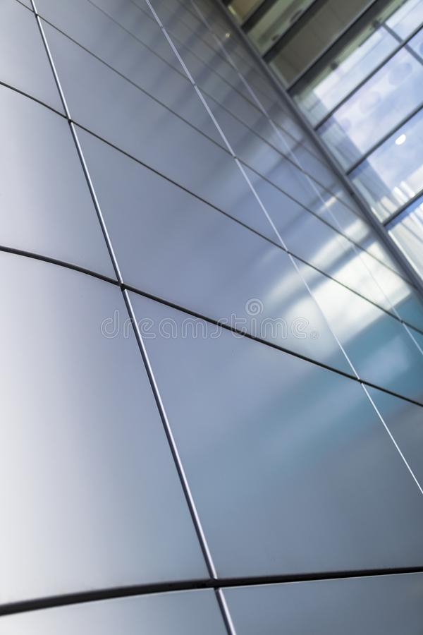 Grey or silver cladding gives an ultra modern and contemporary architectural feel to a building royalty free stock image