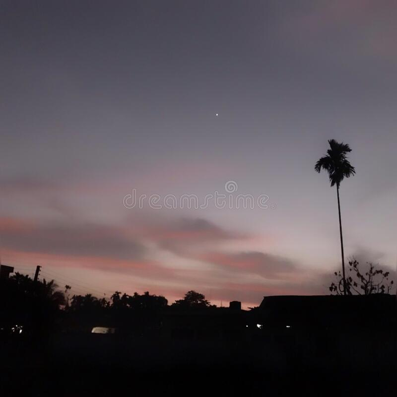 Grey sky. This is a photo of real grey sky . I shot this photo in 6 February 2020 at sunset time. In this photo we can also see a star. In this photo there is no stock photo