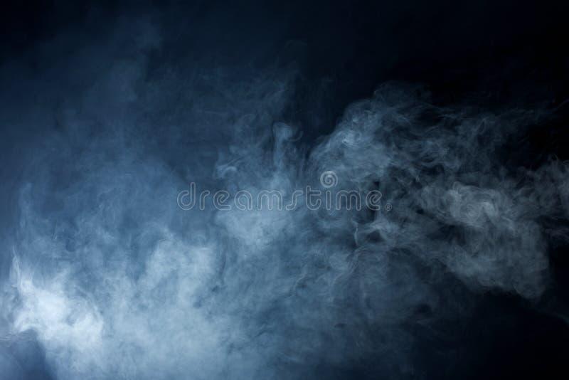 Grey Smoke azul no fundo preto foto de stock royalty free