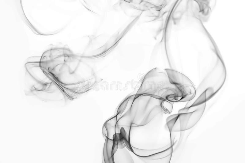 Grey smoke on black background stock image