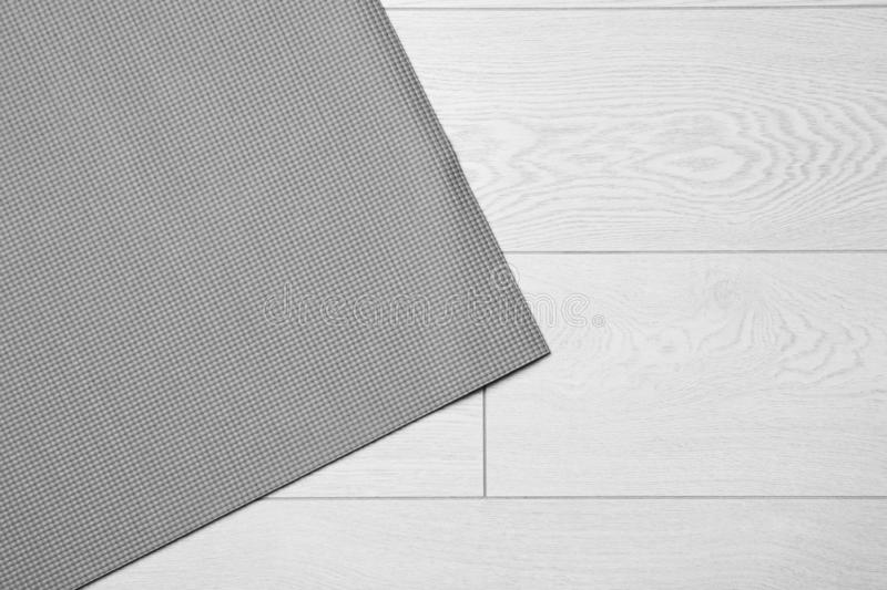 Grey sports mat on wooden background, top view. With space for text stock image