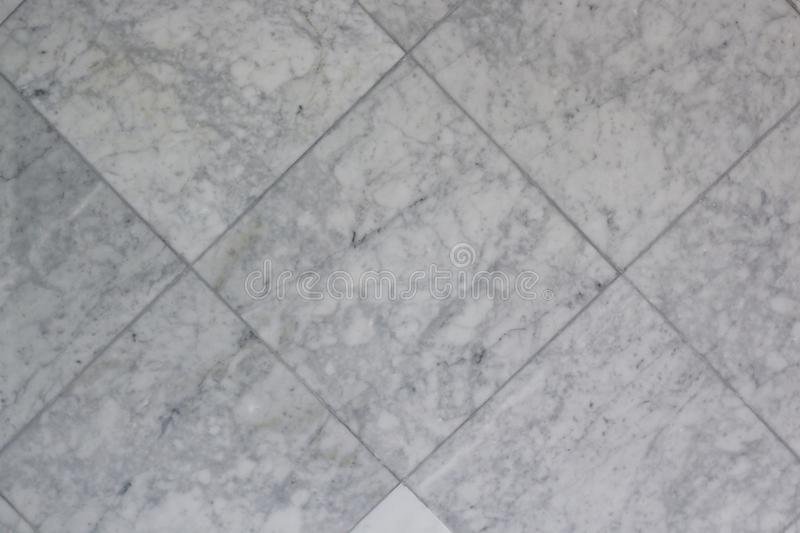 Grey Square Marble Tile Texture. Grey square marble tile pattern and background texture royalty free stock photography