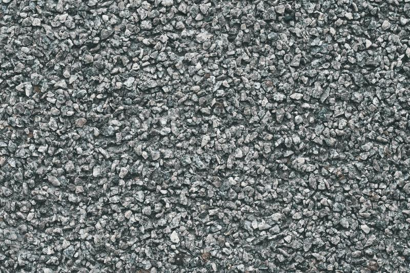 Grey stone background. Abstract pattern of gravel. Natural road texture. Rock material. Grunge floor on street. royalty free stock photo