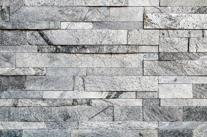 Grey stone wall texture or abstract background. stock photography