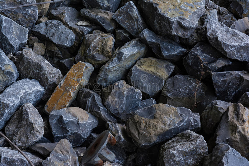 Grey Stones Pile Texture Background-Bouwrotsen stock foto's