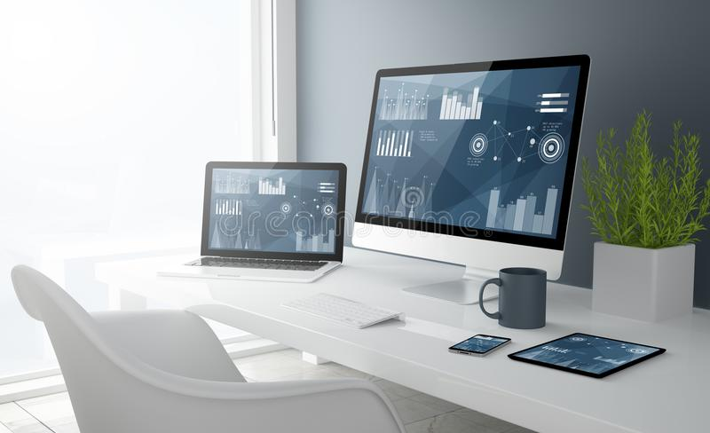 grey studio devices with finances graphics royalty free stock photos