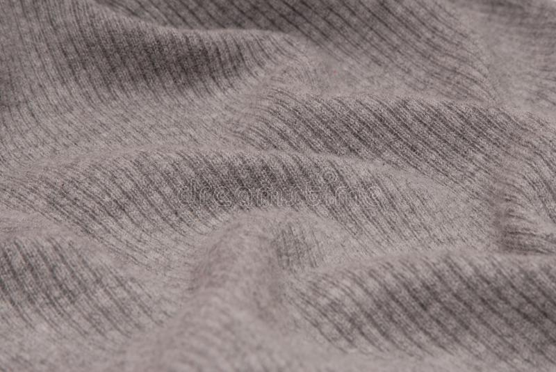 Grey textile background, grey knitted fabric, royalty free stock images
