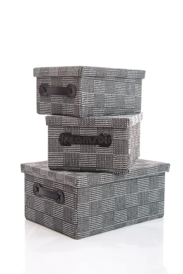 Grey Textile boxs on white background stock photos