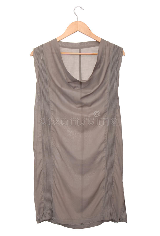 Grey tunic is on clothes-hanger. royalty free stock photography