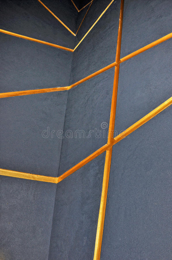Grey wall with orange lines royalty free stock photos