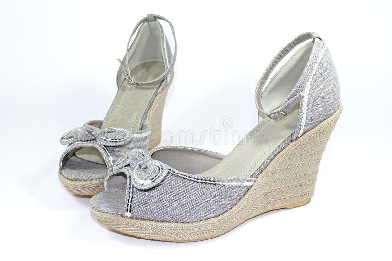 Grey wedge-heeled shoes stock image