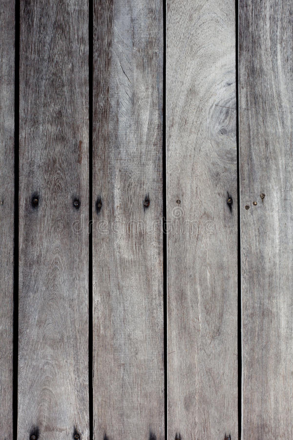 Grey wood background. Aged, with nails royalty free stock photo