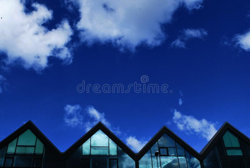 Grey Wood and Glass House Under Blue Sky and Clouds during Daytime stock photography