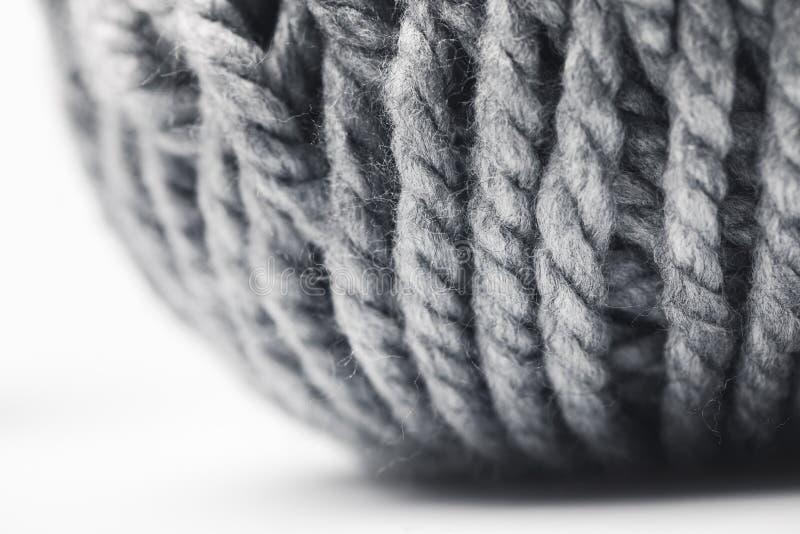 Grey yarn ball on white background. Close up view of grey yarn ball on white background stock photography