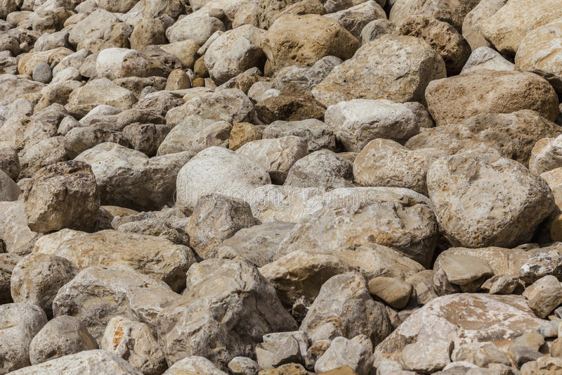 Grey yellow boulders background from side stock image