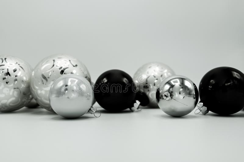 Greyscale elegant christmas decoration baubles. Monochrome elegant Christmas wallpaper background of tree decorations. Classy holidays image in black and white royalty free stock photo