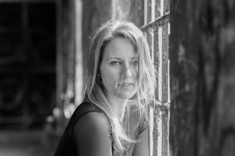 Greyscale image of a beautiful young woman royalty free stock photos