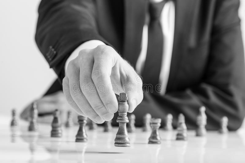Greyscale image of businessman wearing business suit moving dark stock images