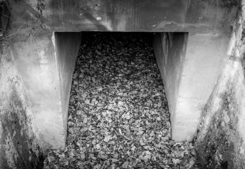 Greyscale image of an old concrete culvert royalty free stock photography